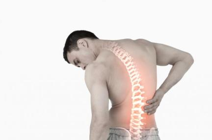 a-man-with-visible-spine-holds-his-back